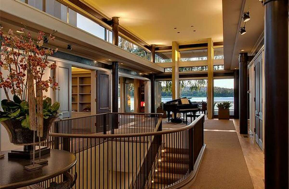 The entry way has high ceilings and a view of Lake Washington through the back. (Windermere.com) See the listing.