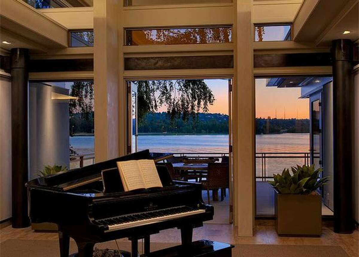 The deck can be seen through the floor-to-ceiling windows. (Windermere.com) See the listing.