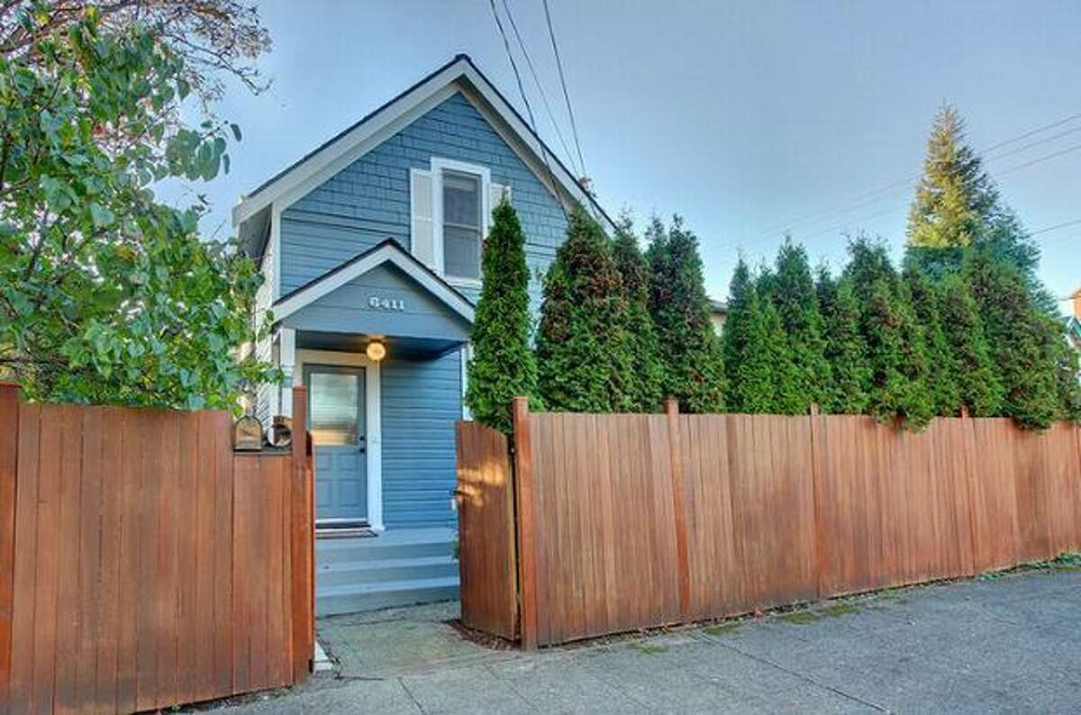 What is the market like for homes around $300,000 in Seattle? Here are four houses in four different neighborhoods. This $319,000 home at 6411 22nd Ave NW near Ballard has two bedrooms and 1.5 bathrooms. Built in 1906, this 1,280-square-foot house has a fully fenced private yard, energy-efficient gas fireplace and a new kitchen with Energy Star appliances. (Windermere.com) See the listing.