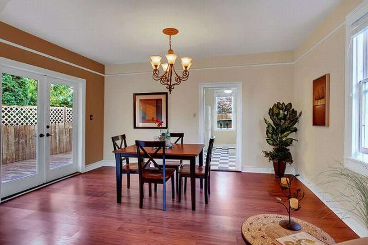 The dining room has all hardwood floors and has French doors that open up to a large entertainment deck in the back. (Windermere.com) See the listing.