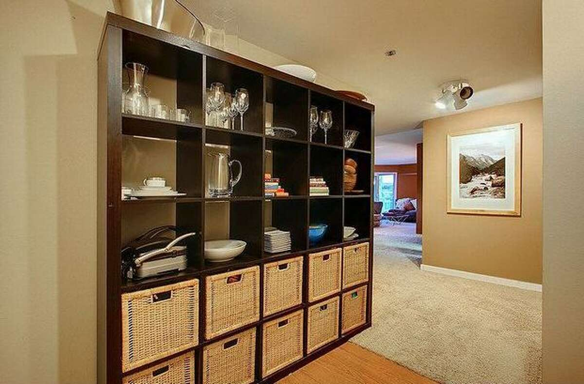 The large entry way into the condo has partial carpeting and hardwood floors. (Windermere.com) See the listing.