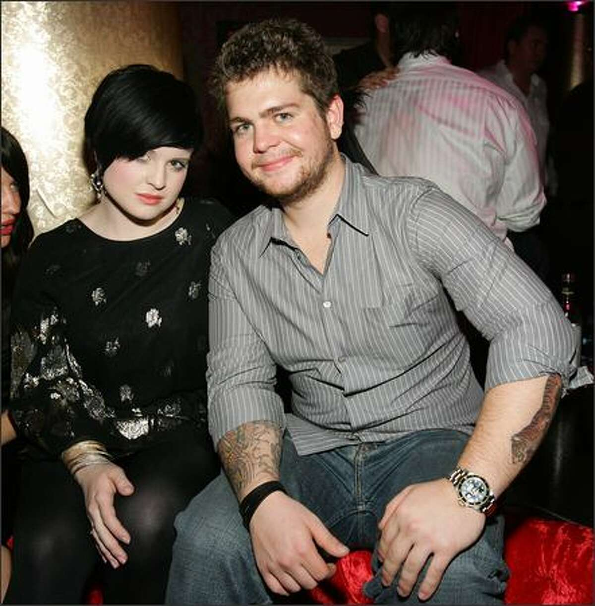 Kelly Osbourne and Jack Osbourne pose at the grand opening of the CatHouse at the Luxor Resort & Casino.