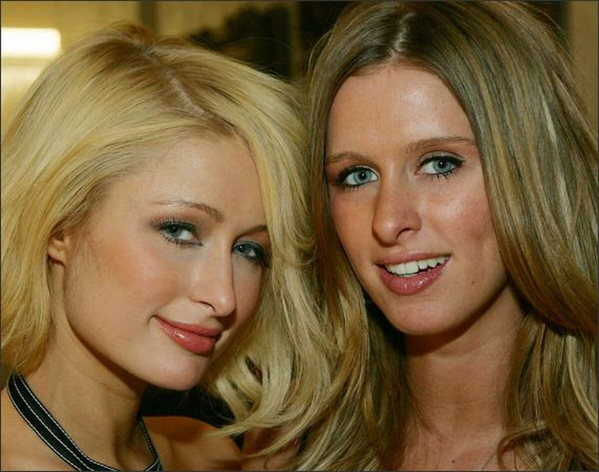 Paris Hilton (L) and her sister Nicky Hilton appear at the grand opening of Color - A Salon by Michael Boychuck at Caesars Palace in Las Vegas, Nevada.