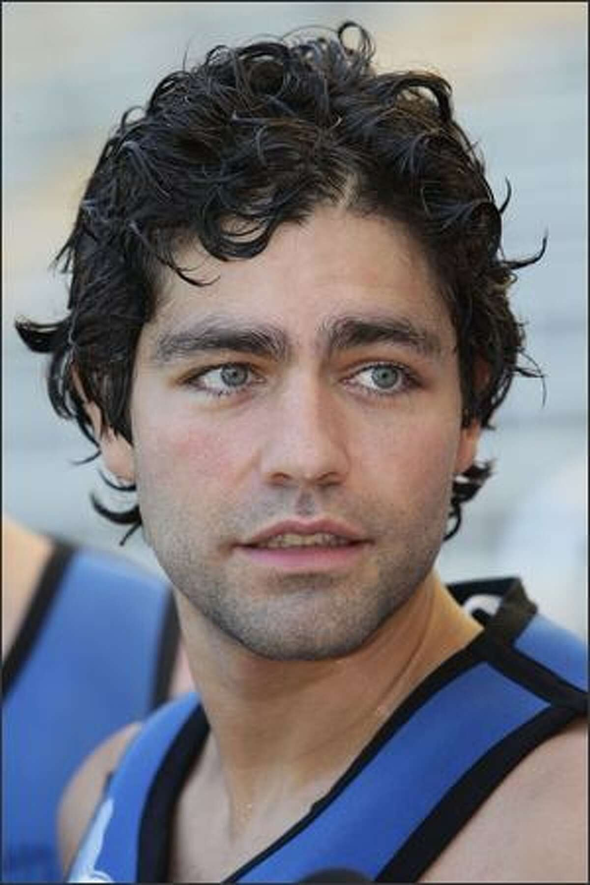 Actor Adrian Grenier swims with dolphins at Sea World on the Gold Coast in Australia.