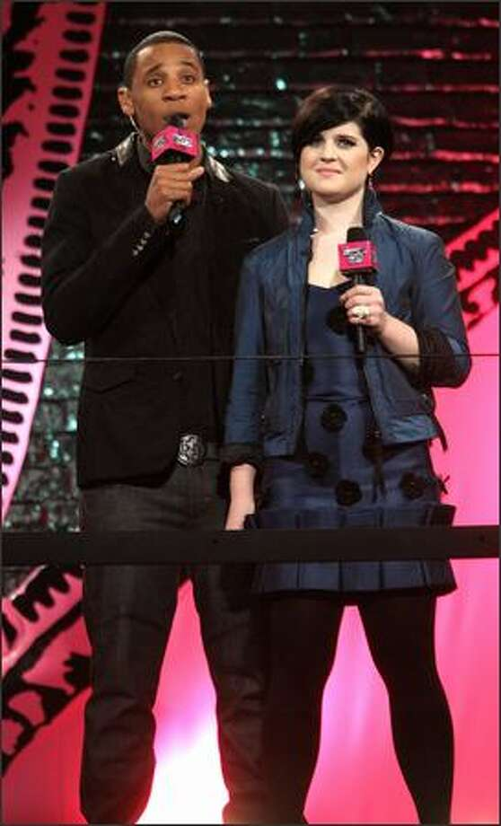 Hosts Reggie Yates and Kelly Osbourne present artists on stage at the BRITs Nominations Launch Party at the Roundhouse, Camden in London, England. Photo: Getty Images / Getty Images