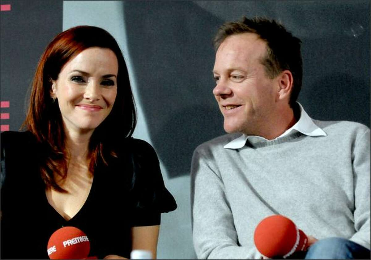Actress Annie Wersching and actor Kiefer Sutherland smile during a photo call to promote the serial