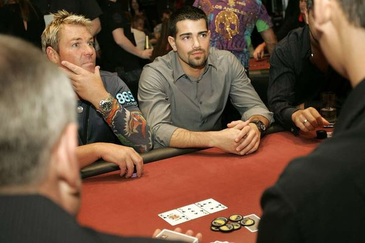 Cricketer Shane Warne and Actor Jesse Metcalfe participate in the Celebrity Poker Challenge as part of the 2010 Aussie Millions Poker Championship at Crown Casino in Melbourne, Australia.