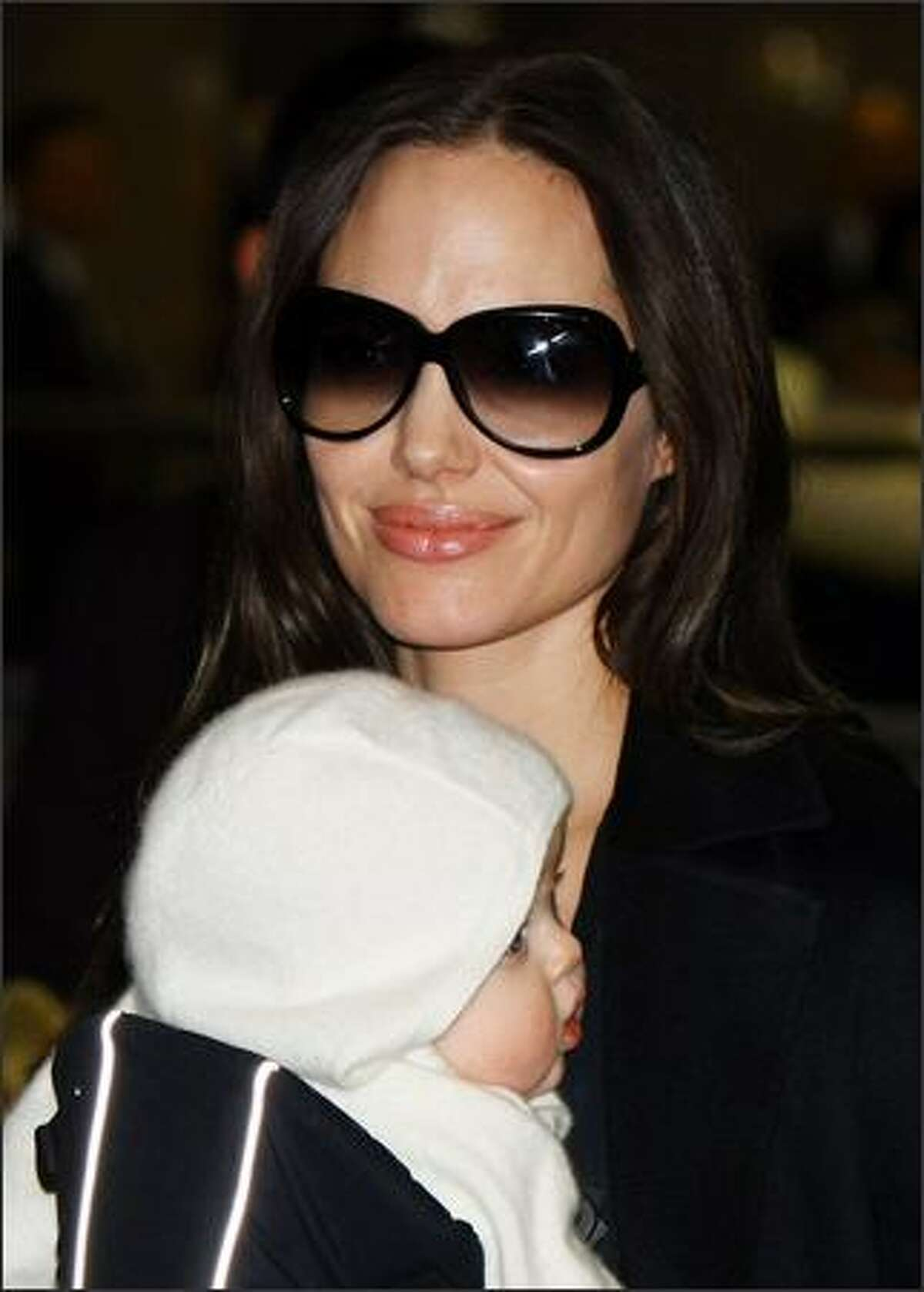 Actress Angelina Jolie arrives at Narita International Airport with her baby, Vivienne, in Narita, Chiba, Japan. Angelina is visiting Japan to promote her film