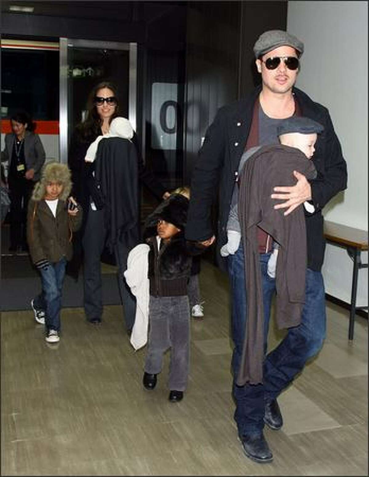 Actor Brad Pitt and Angelina Jolie arrive at Narita International Airport with their children (L to R) Maddox, Vivienne, Zahara and Knox in Narita, Chiba, Japan. Brad is visiting Japan to promote his film