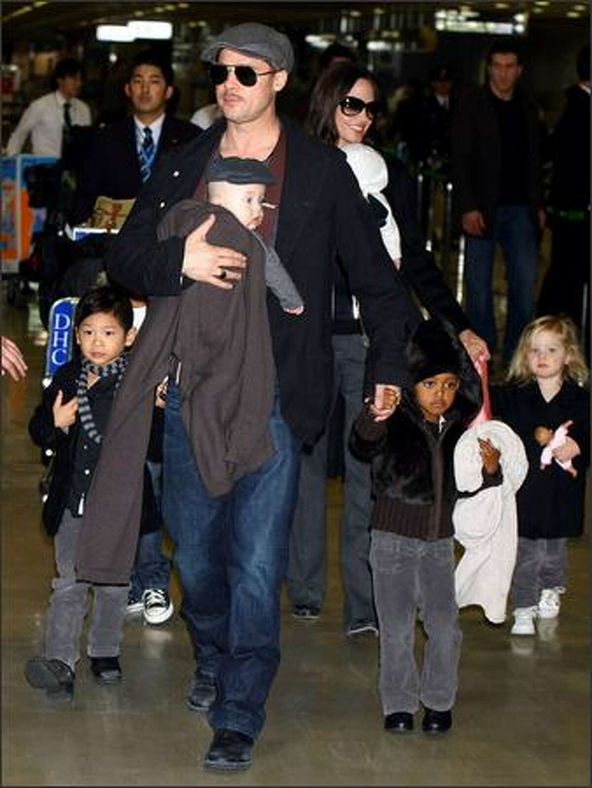 Actor Brad Pitt and Angelina Jolie arrive at Narita International Airport with their children (L to R) Pax Thien, Knox, Zahara and Shiloh in Narita, Chiba, Japan. Brad is visiting Japan to promote his film