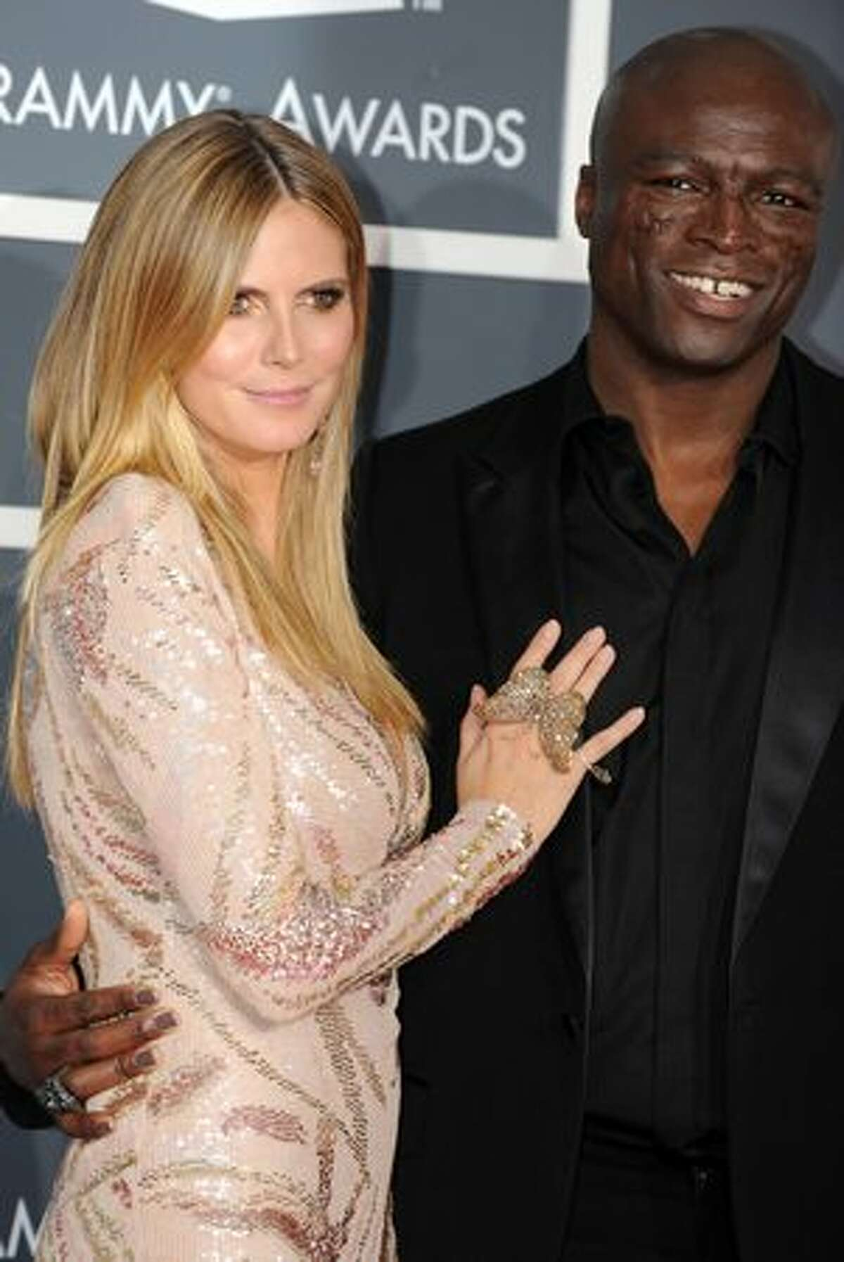 Musician Seal and his wife, top model Heidi Klum arrive on the red carpet at the 52nd Grammy Awards in Los Angeles, California on January 31.