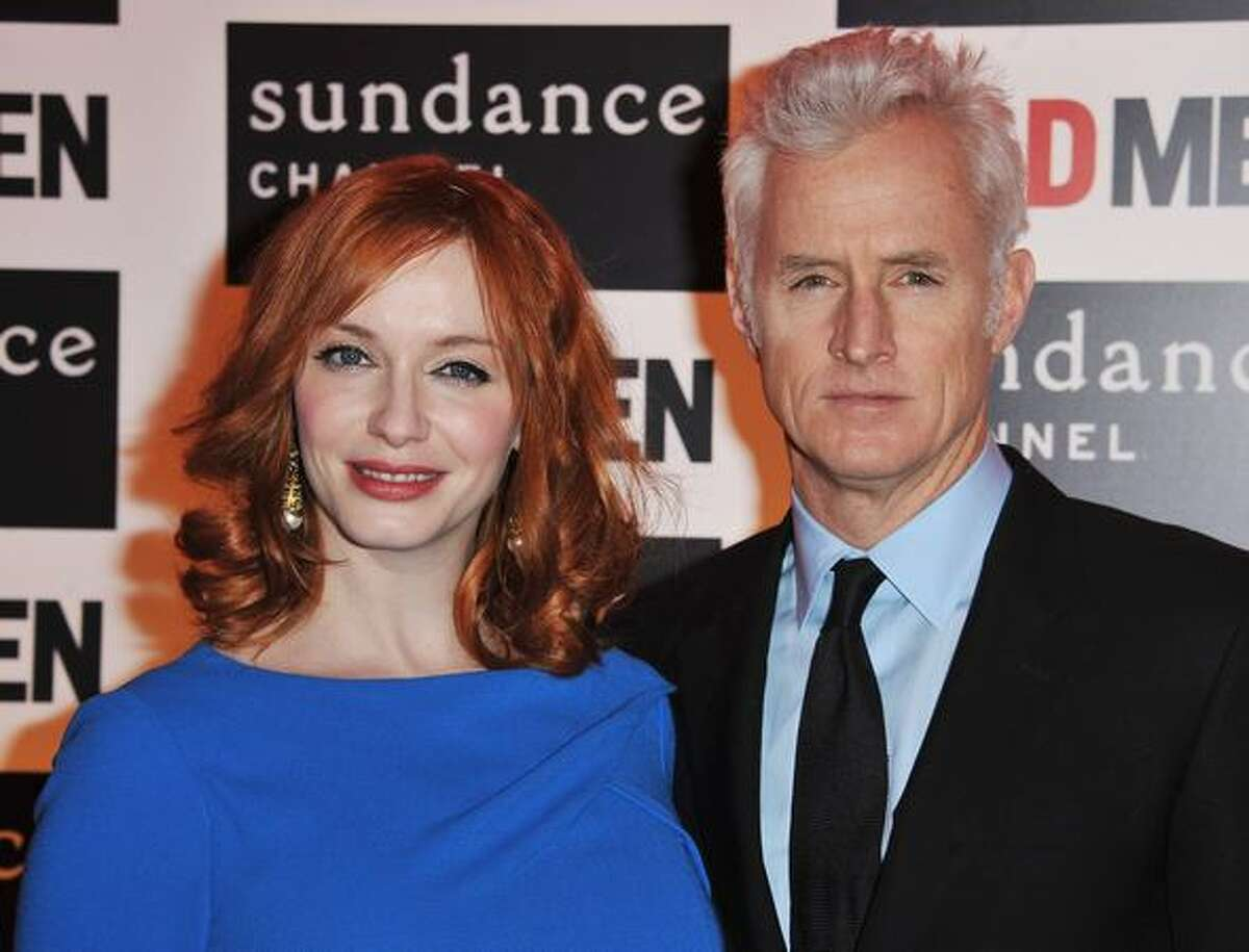 PARIS, FRANCE - (L-R) Actors Christina Hendricks and John Slattery attend the AMC - Mad Men Gala Event at Hotel Royal Monceau Raffle on Tuesday in Paris, France.