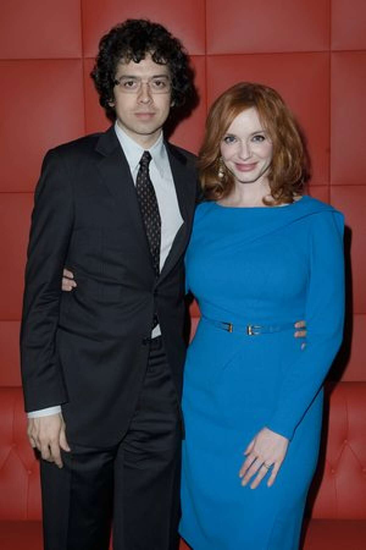 PARIS, FRANCE - Actors Christina Hendricks (R) and Geoffrey Arend pose during the AMC - Mad Men Gala Event at Hotel Royal Monceau Raffle on Tuesday in Paris, France.