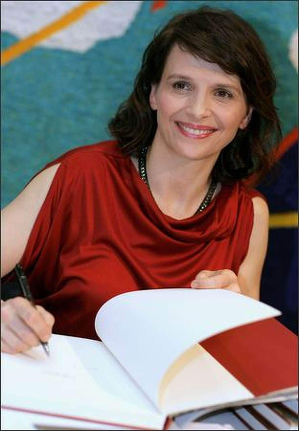 Actress Juliette Binoche signs autographs at the official launch of her latest book