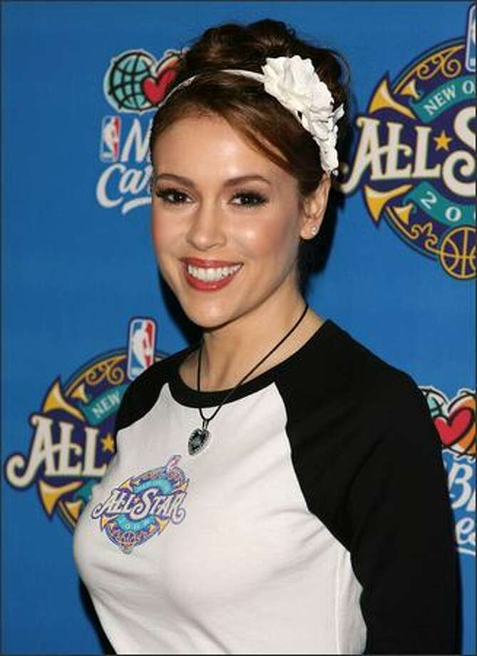 Actress Alyssa Milano arrives at the 57th NBA All-Star Game, part of 2008 NBA All-Star Weekend at the New Orleans Arena. Photo: Getty Images / Getty Images