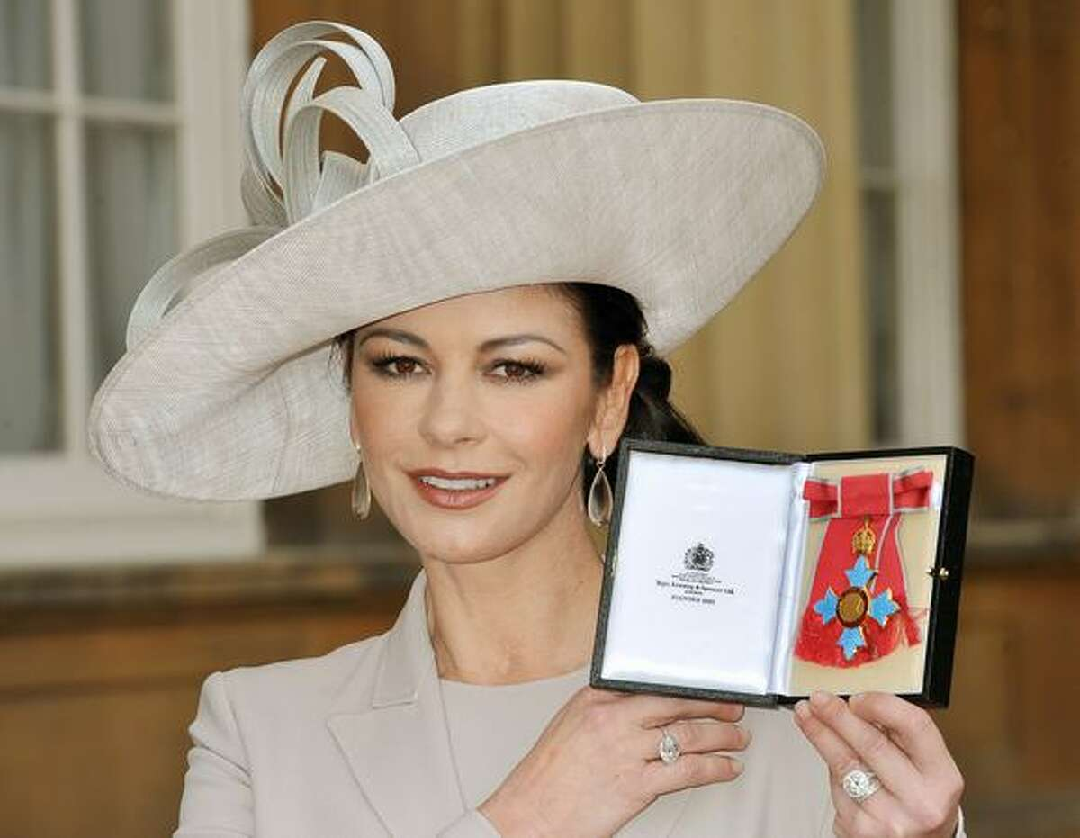 Actress Catherine Zeta Jones poses after she was made a Commander of the British Empire (CBE) by the Prince of Wales at Buckingham Palace in London, England.