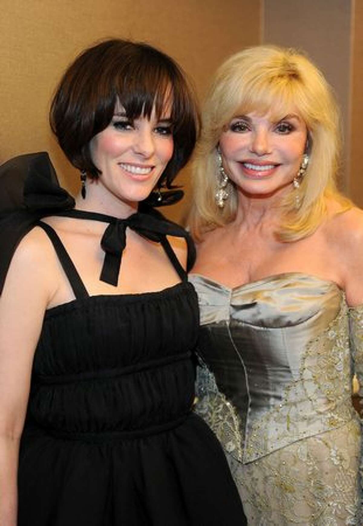 Actresses Parker Posey (L) and Loni Anderson backstage during the 12th Annual Costume Designers Guild Awards with Presenting Sponsor Swarovski at The Beverly Hilton hotel in Beverly Hills, California.