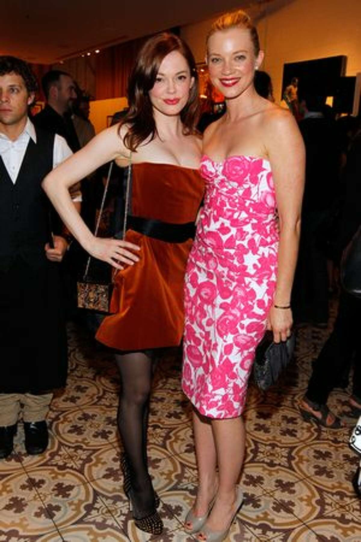 Actresses Rose McGowan and Amy Smart attend Art of Elysium's