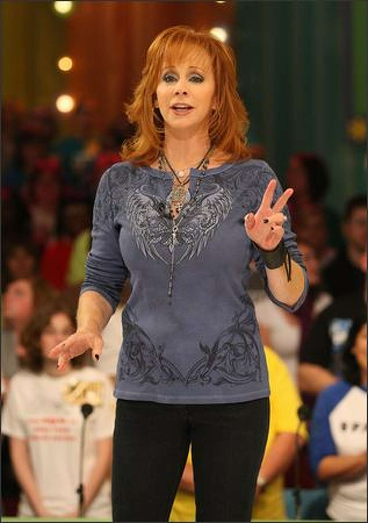 Actress/recording artist Reba McEntire speaks during a segment of