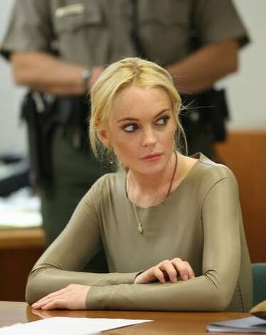 Actress Lindsay Lohan appears at Los Angeles Airport Courthouse for a preliminary hearing on March 10, 2011, in Los Angeles. Lohan, who is accused of stealing a $2,500 necklace in January from a jewelry store in Venice, Calif., is attending a preliminary hearing where she is expected to reject a plea deal. Photo: Getty Images / Getty Images