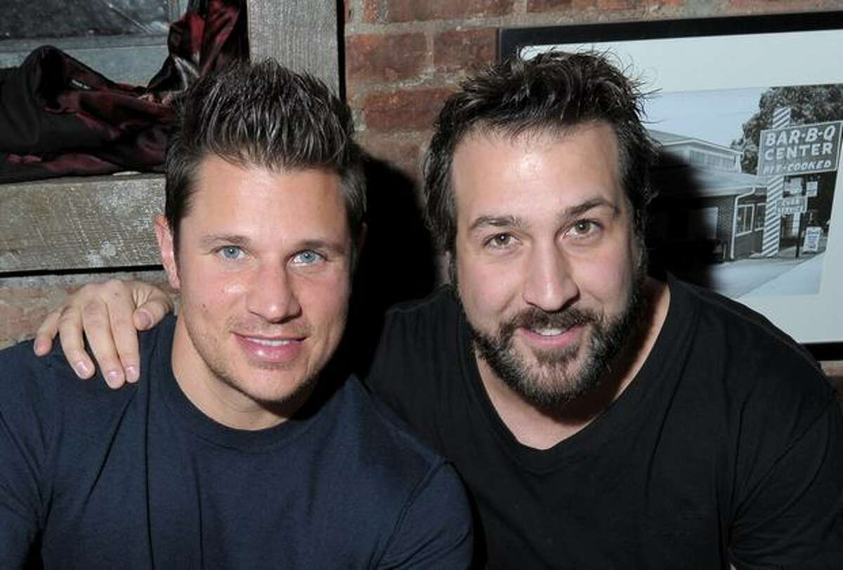 Singers (L-R) Nick Lachey and Joey Fatone attend the Brother Jimmy's Union Square grand opening at Brother Jimmy's in New York City.