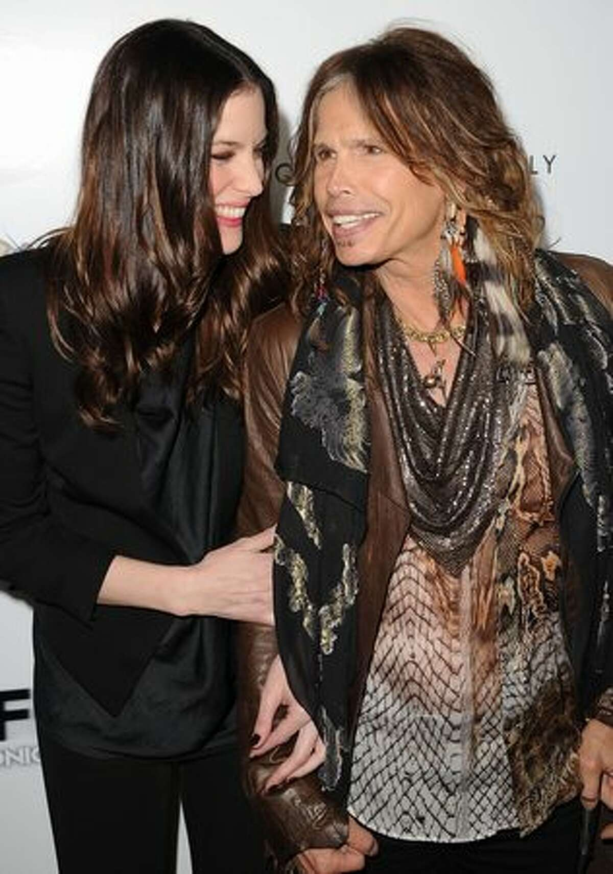 Actress Liv Tyler and singer Steven Tyler arrive at the premiere of IFC Midnight's 'Super' at the Egyptian Theatre in Hollywood, California.