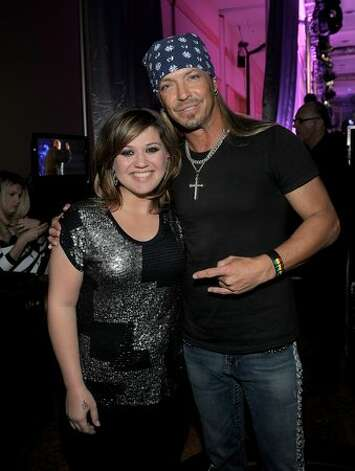 Singers Kelly Clarkson (L) and Bret Michaels attend Muhammad Ali's Celebrity Fight Night XVII at JW Marriot Desert Ridge Resort & Spa in Phoenix, Arizona. Photo: Getty Images / Getty Images