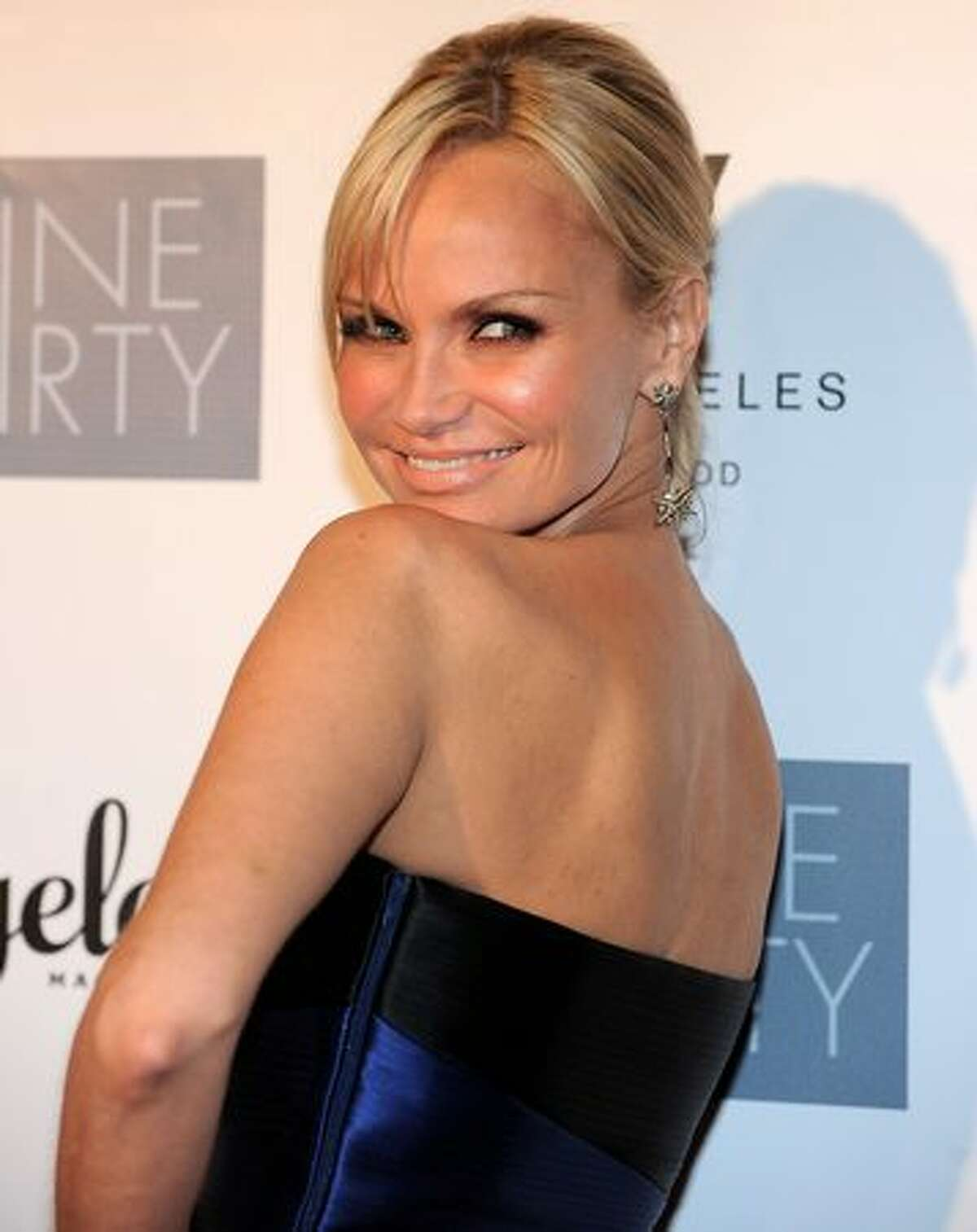 Actress/singer Kristin Chenoweth poses on the red carpet at the Geffen Playhouse's Annual Backstage at the Geffen Gala in Los Angeles, California.