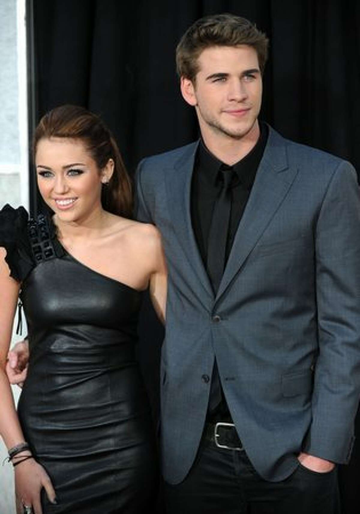 """Actress and singer Miley Cyrus and actor Liam Hemsworth arrive for the premiere of """"The Last Song"""" in Hollywood, California."""