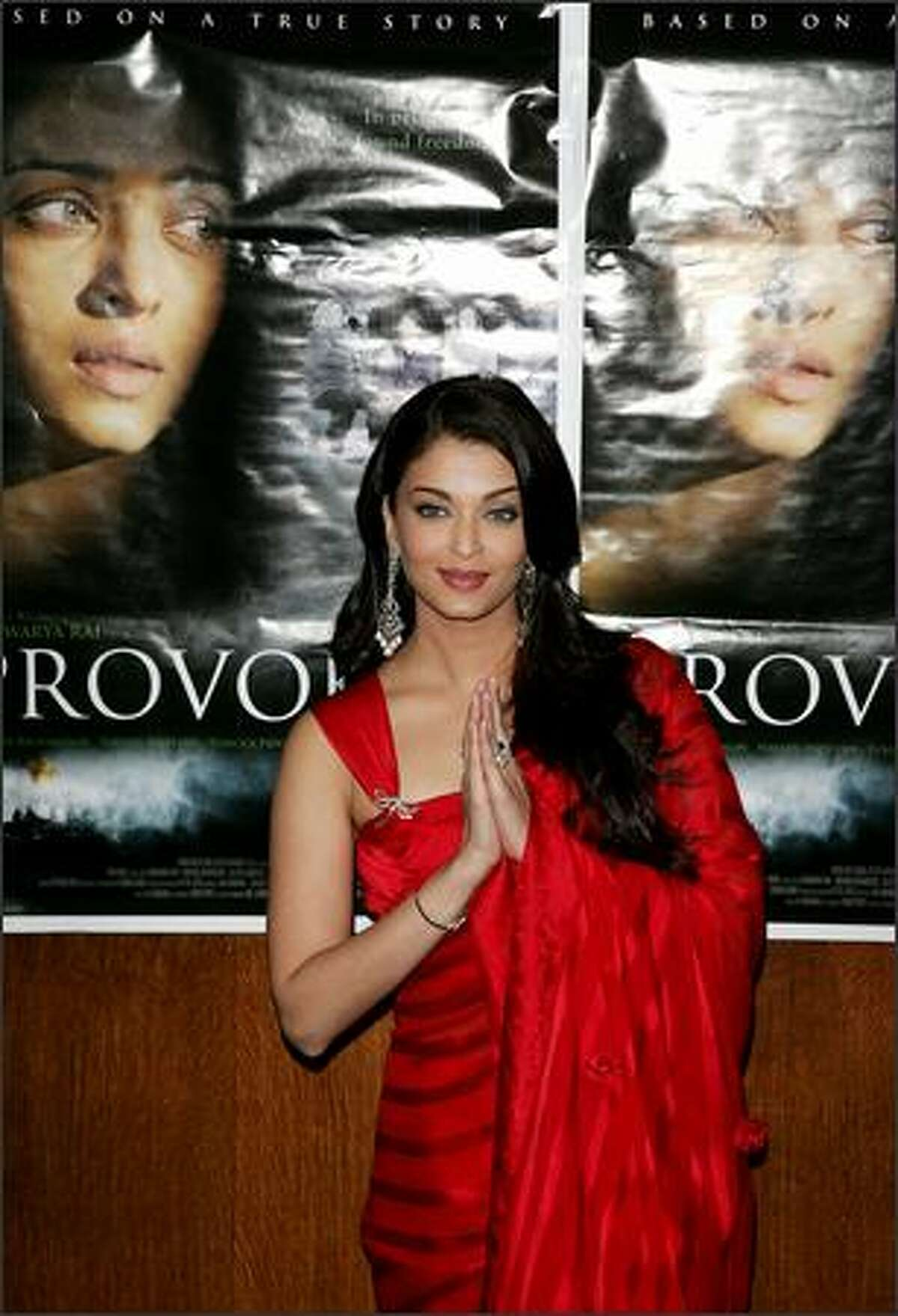 Bollywood actress and L'Oreal spokes model girl Aishwarya Rai poses for media during the launch of her film 'Provoked' in London, Tuesday. The film is based on Kiranjit Ahluwalia's autobiography 'Circle of Light' by Rahila Gupta which depicts her struggle in an abusive marriage. (AP Photo/Sang Tan)
