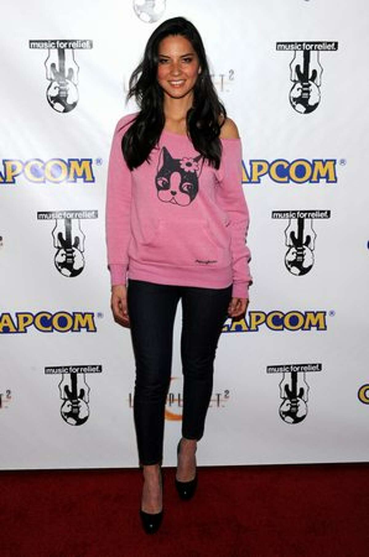 Olivia Munn arrives at the launch party of Capcom's