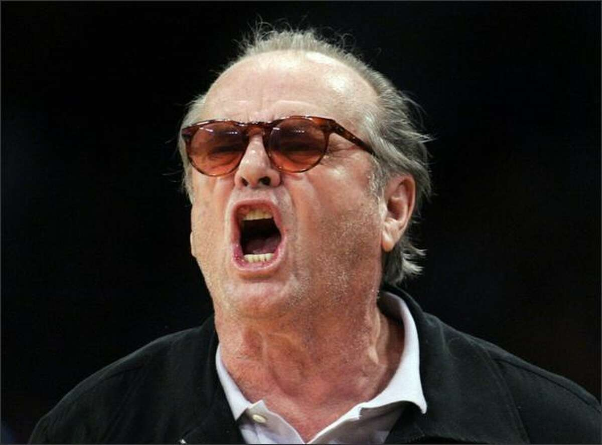 Actor Jack Nicholson yells at the referee during the second half of Game 2 of their NBA Western Conference semi-final basketball playoff game between the Houston Rockets and the Los Angeles Lakers in Los Angeles. (REUTERS/Danny Moloshok)