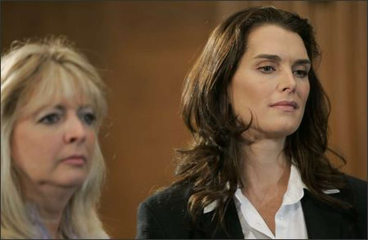 Actress Brooke Shields, right, and Mary Jo Codey, a longtime postpartum depression advocate, and wife of former New Jersey Gov. Richard Codey, left, listen during a news conference on Capitol Hill in Washington, Friday, to support legislation for federal investment in postpartum depression education, detection and treatment. (AP Photo/Susan Walsh)