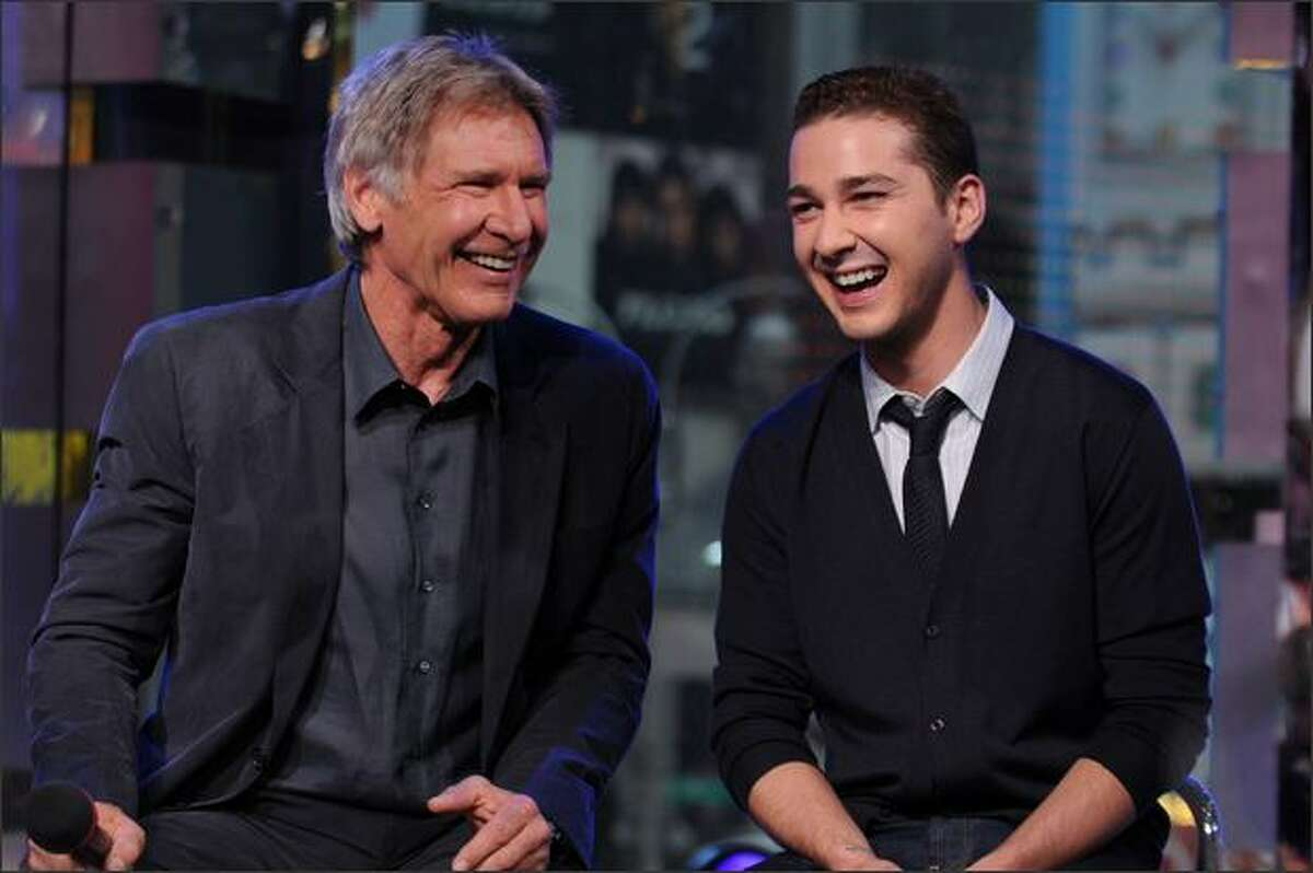 Actors Harrison Ford (L) and Shia LeBeouf appear onstage during MTV's Total Request Live at the MTV Times Square Studios in New York City.