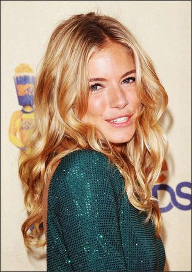Actress Sienna Miller arrives at the 18th Annual MTV Movie Awards held at the Gibson Amphitheatre in Universal City, California. Photo: Getty Images / Getty Images