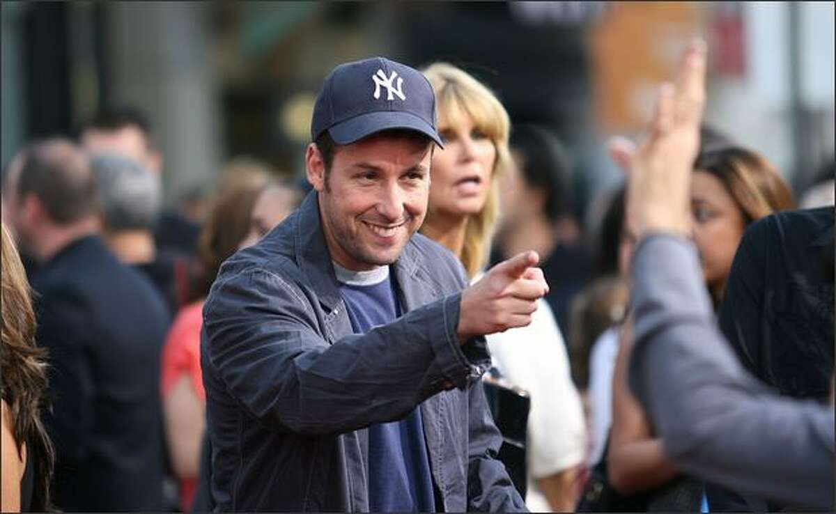 """Actor Adam Sandler speaks to a fan during the """"You Don't Mess With The Zohan"""" film premiere at Grauman's Chinese Theatre in Hollywood, California."""