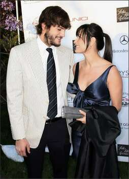 Actor Ashton Kutcher (L) and actress Demi Moore attend the Seventh Annual Crysalis Butterfly Ball in Brentwood, California. Photo: Getty Images / Getty Images