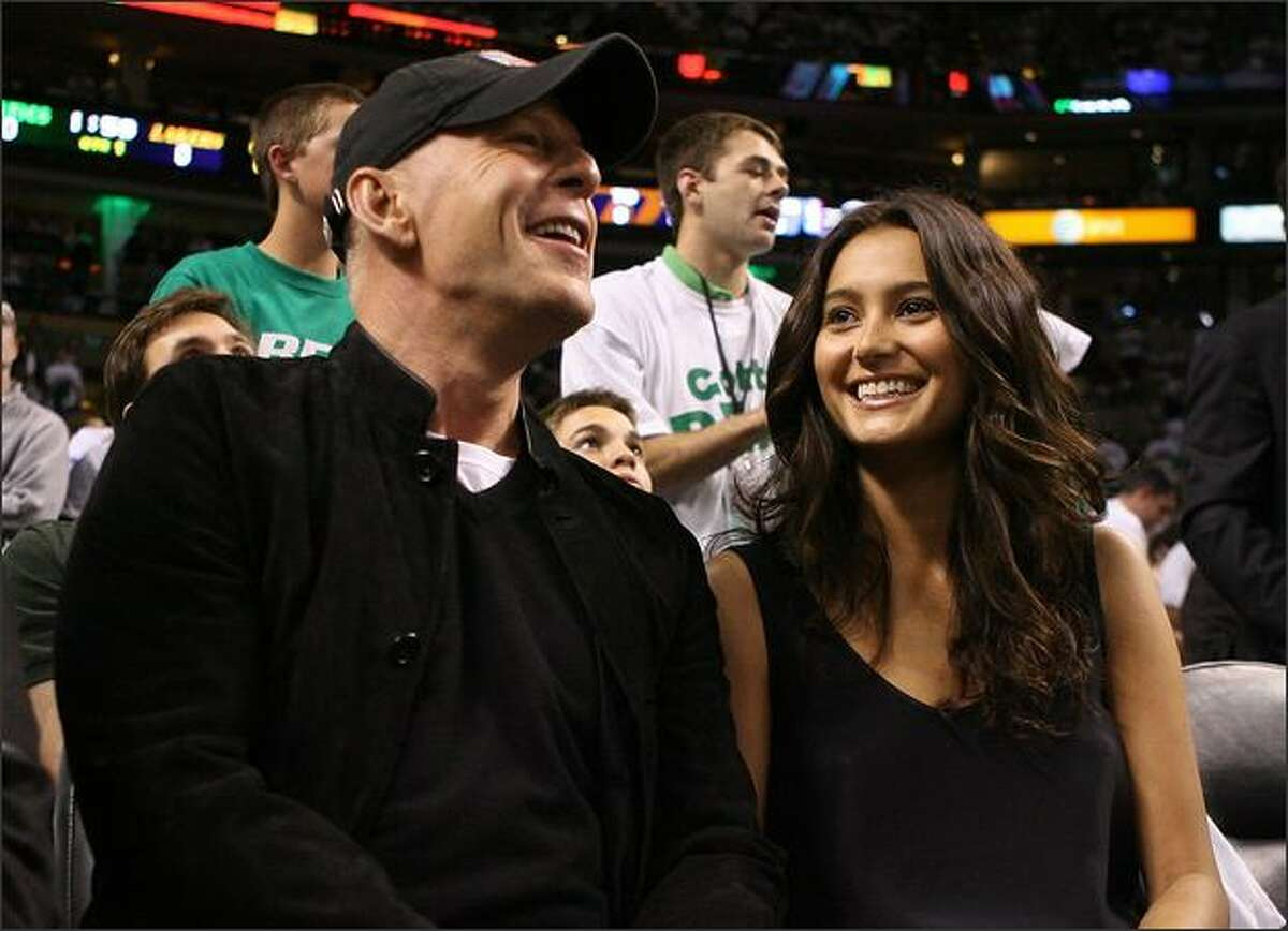 Actor Bruce Willis and model Emma Hemming attend Game One of the 2008 NBA Finals between the Los Angeles Lakers and the Boston Celtics at TD Banknorth Garden in Boston, Massachusetts.