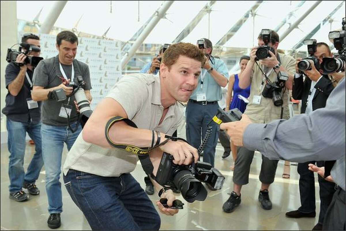 """Actor David Boreanaz jokes around with photographers and borrows a camera as he attends a photocall promoting the television series """"Bones"""" on the third day of the 2008 Monte Carlo Television Festival held at Grimaldi Forum in Monaco."""
