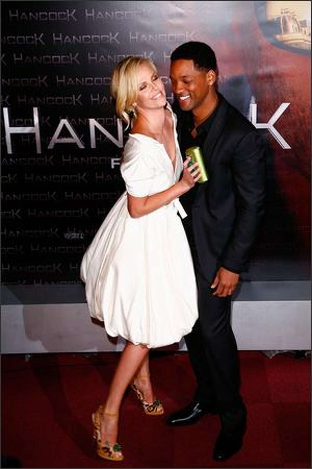 Charlize Theron and Will Smith attend the movie premiere of