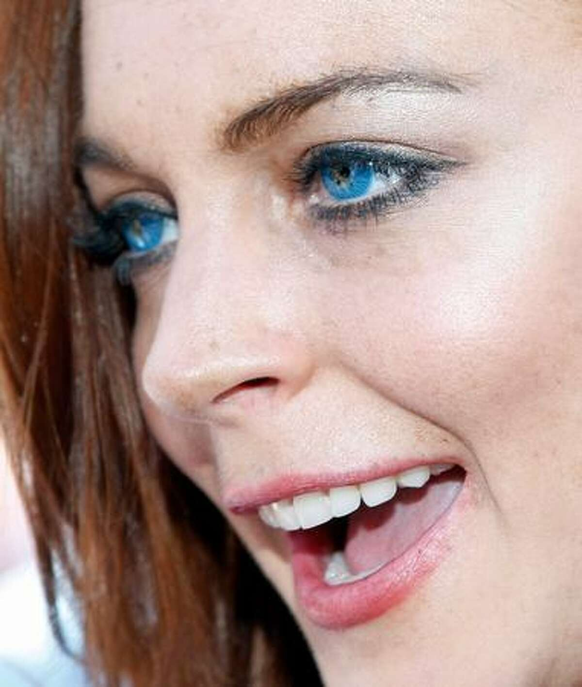 Actress Lindsay Lohan is interviewed as she arrives at the Wet Republic pool at the MGM Grand Hotel/Casino to celebrate her birthday and her Sevin Nyne brand tanning mist in Las Vegas, Nevada. Lohan turns 23 on July 2.