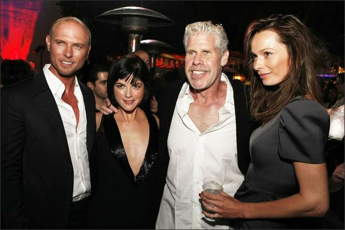 (L to R) Actors Luke Goss, Selma Blair, Ron Perlman and Anna Walton pose at the after party for the world premiere of Universal Picture's