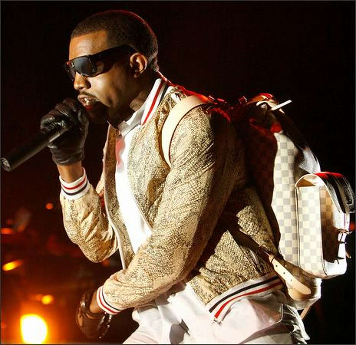 Kanye West performs at the Louisiana Superdome during the 2008 Essence Music Festival in New Orleans, Louisiana.