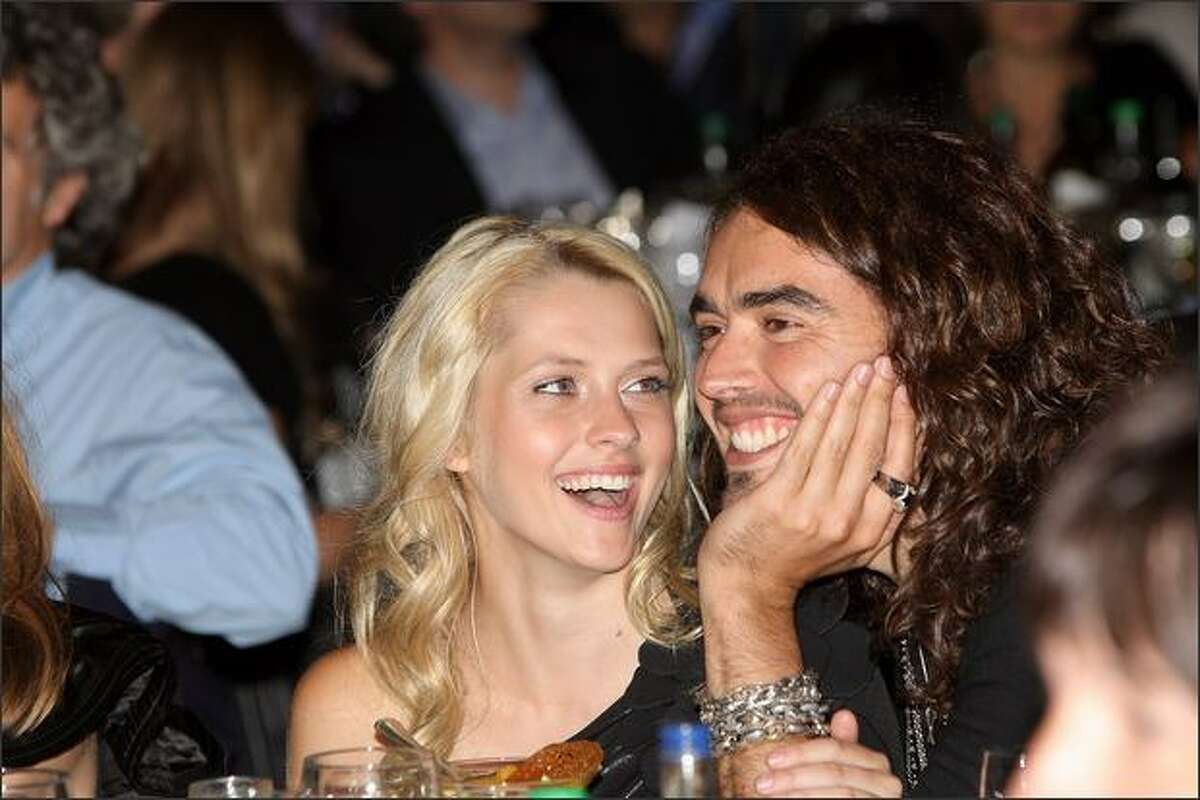 Actor Russell Brand and Teresa Palmer attend The O2 Silver Clef Awards Luncheon in aid of Nordoff-Robbins Music Therapy at The Hilton Park Lane in London, England.