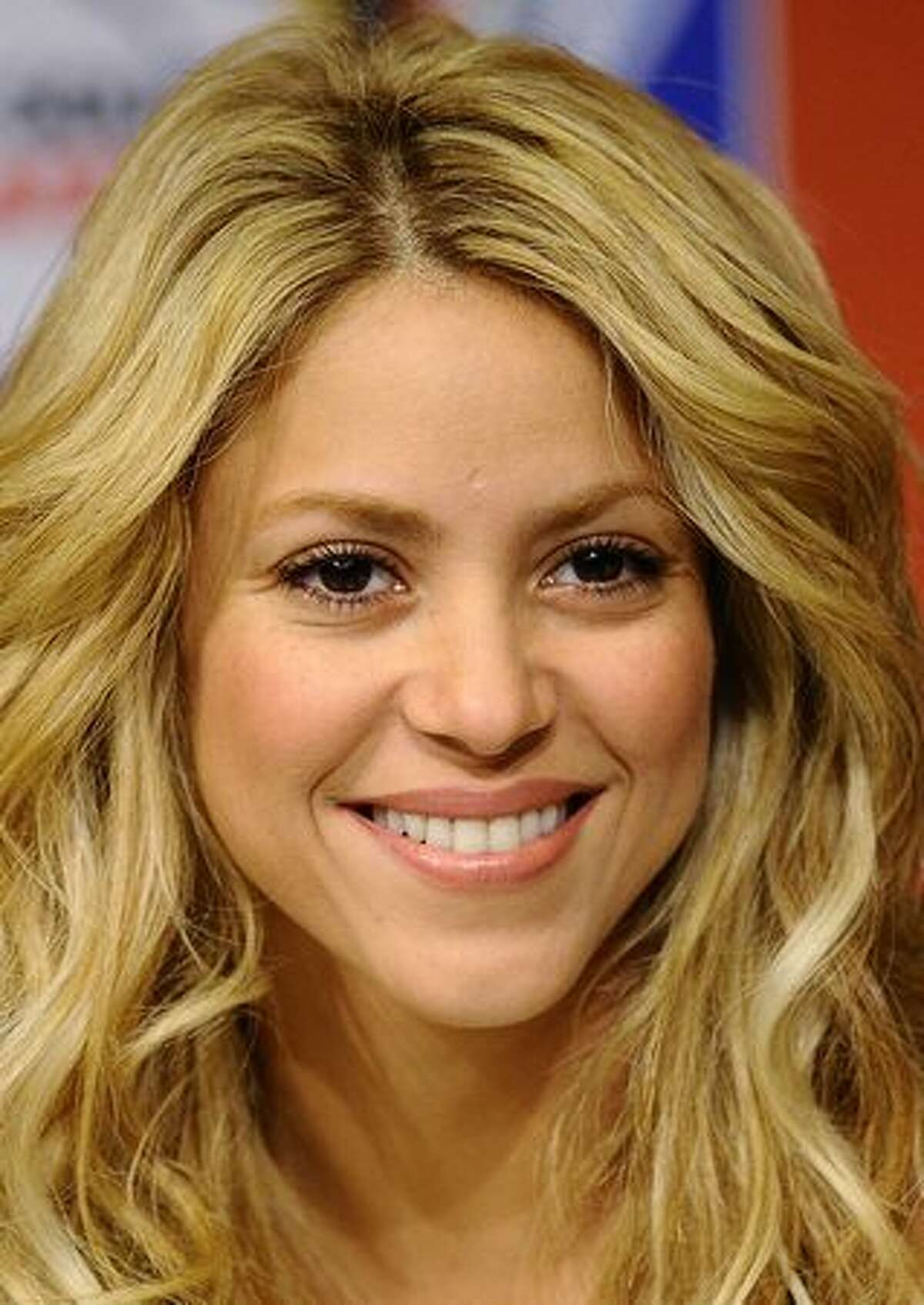 Colombian singer Shakira smiles during a press conference at Soccer City Stadium in Soweto.
