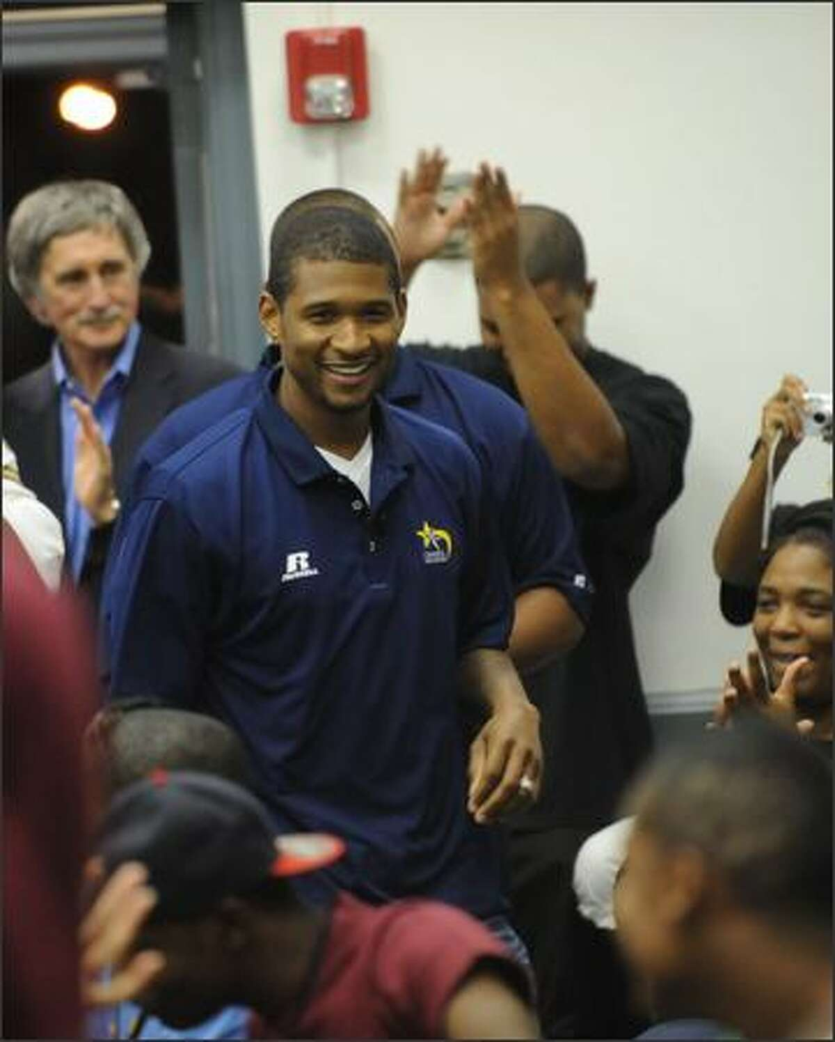 Usher arrives at his 4th Annual Camp New Look held at The Georgia Tech campus in Atlanta, Georgia.