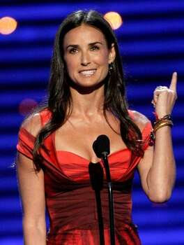 Actress Demi Moore presents an award onstage during the 2009 ESPY Awards held at Nokia Theatre LA Live in Los Angeles, California. Photo: Getty Images / Getty Images