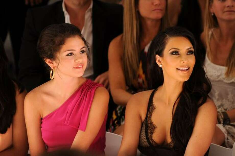 Actress Selena Gomez and Kim Kardashian attend the Beach Bunny Swimwear 2011 fashion show during Mercedes-Benz Fashion Week Swim at the Raleigh. Photo: Getty Images / Getty Images
