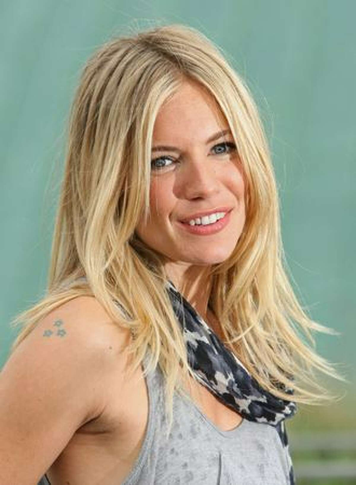 Actress Sienna Miller attends the photocall for