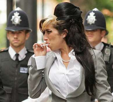 """British singer Amy Winehouse arrives at Westminster Magistrates Court in central London. British singer Amy Winehouse launched an """"unjustifiable"""" attack on a female fan who politely asked her for a photograph at a charity ball, a court heard on July 23. The 25-year-old songstress -- said to be on the road to recovery from her drug addiction -- denies beating Sherene Flash, a dancer, in an incident in Berkeley Square, central London, on September 26, 2008. Photo: Getty Images / Getty Images"""